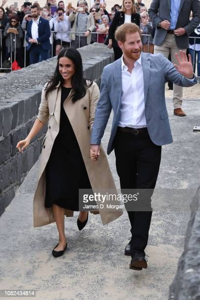Prince Harry Duke of Sussex and Meghan Duchess of Sussex attend an event on South Melbourne beach on October 18 2018 in Melbourne Australia The Duke...