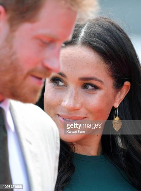 Prince Harry Duke of Sussex and Meghan Duchess of Sussex attend an official welcome ceremony and unveil a new statue commemorating Sergeant Talaiasi...