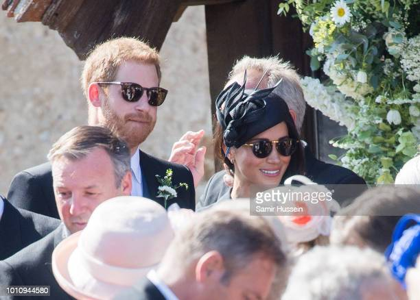 Prince Harry Duke of Sussex and Meghan Duchess of Sussex attend the wedding of Charlie Van Straubenzee on August 4 2018 in Frensham United Kingdom...
