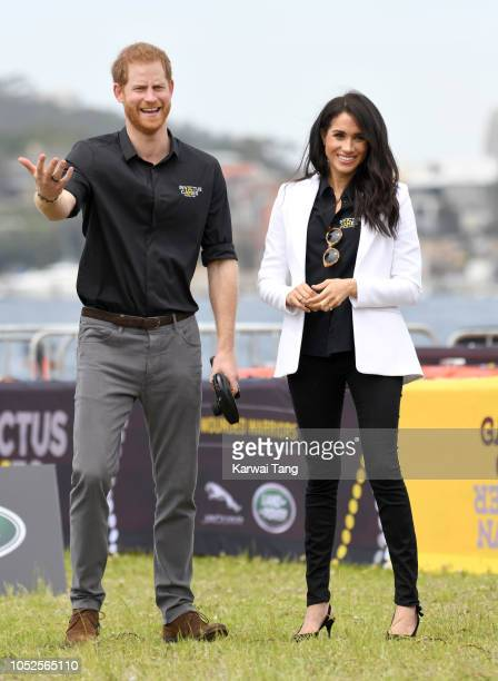 Prince Harry Duke of Sussex and Meghan Duchess of Sussex attend the Invictus Games Sydney 2018 Jaguar Land Rover Driving Challenge on Cockatoo Island...