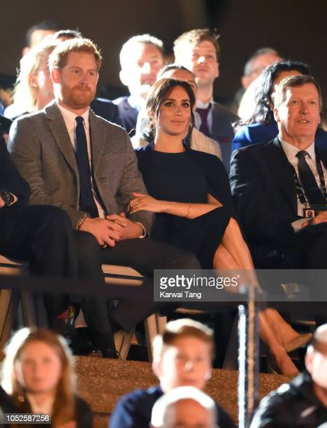 Prince Harry Duke of Sussex and Meghan Duchess of Sussex attend the Invictus Games Opening Ceremony at the Sydney Opera House on October 20 2018 in...