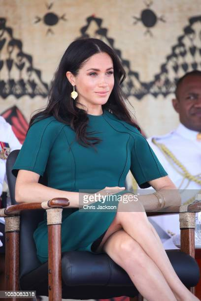 Prince Harry Duke of Sussex and Meghan Duchess of Sussex attend the Unveiling of the Labalaba Statue Meghan Duchess of Sussex looking straight to...