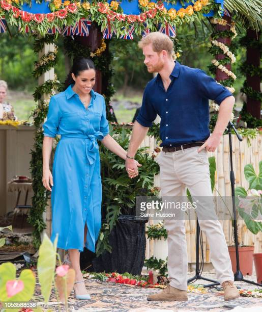 Prince Harry, Duke of Sussex and Meghan, Duchess of Sussex attend the unveiling of The Queen's Commonwealth Canopy at Tupou College on October 26,...