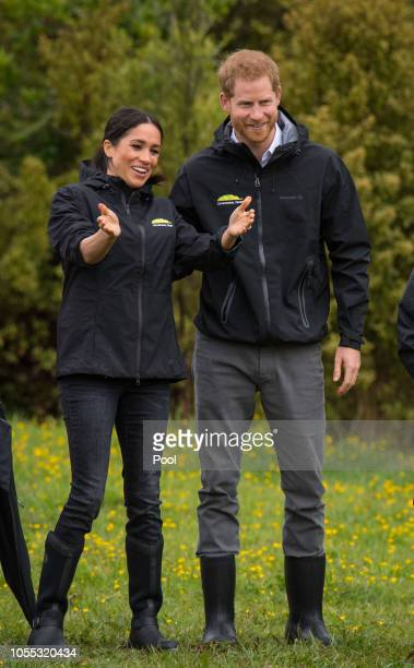 Prince Harry Duke of Sussex and Meghan Duchess of Sussex attend the unveiling of The Queen's Commonwealth Canopy in Redvale on October 30 2018 in...