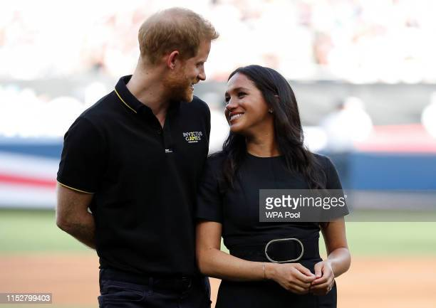 Prince Harry Duke of Sussex and Meghan Duchess of Sussex attend the Boston Red Sox vs New York Yankees baseball game at London Stadium on June 29...