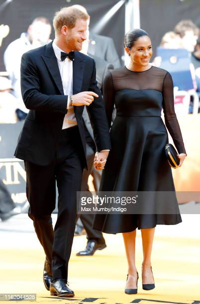 Prince Harry Duke of Sussex and Meghan Duchess of Sussex attend The Lion King European Premiere at Leicester Square on July 14 2019 in London England