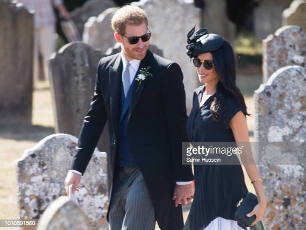 Prince Harry Duke of Sussex and Meghan Duchess of Sussex attends the wedding of Charlie Van Straubenzee on August 4 2018 in Frensham United Kingdom...