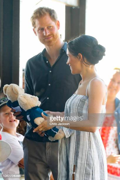 Prince Harry, Duke of Sussex and Meghan, Duchess of Sussex being given teddy bears along a wharf in Kingfisher bay on October 22, 2018 in Fraser...