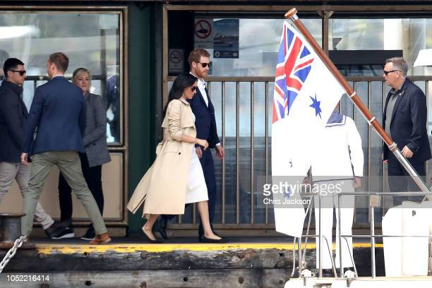 Prince Harry Duke of Sussex and Meghan Duchess of Sussex board a boat from Taronga Zoo and head to the Man O'War Steps on October 16 2018 in Sydney...