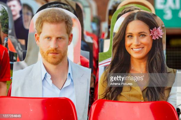 Prince Harry Duke of Sussex and Meghan Duchess of Sussex cardboard cut outs in the stand during the Sky Bet Championship match between Nottingham...