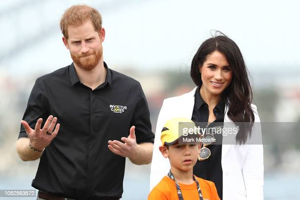 Prince Harry, Duke of Sussex and Meghan, Duchess of Sussex control remote control cars during the JLR Drive Day at Cockatoo Island on October 20,...