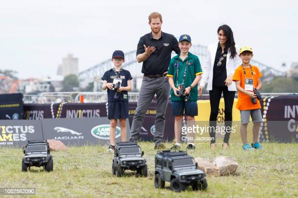 Prince Harry Duke of Sussex and Meghan Duchess of Sussex controls remote control car during the JLR Drive Day at Cockatoo Island on October 20 2018...