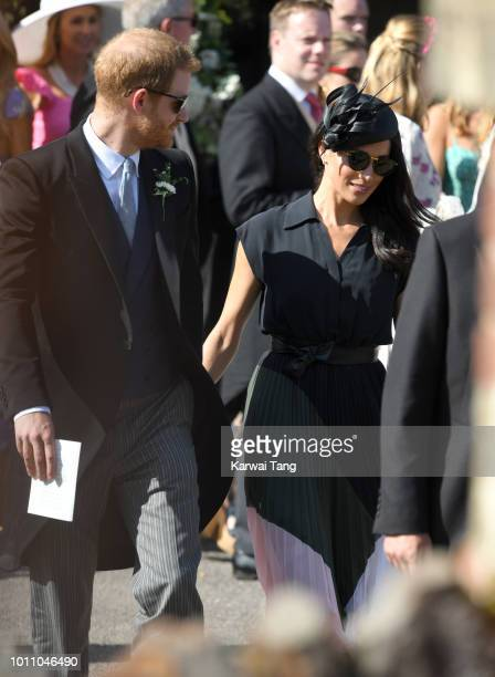 Prince Harry Duke of Sussex and Meghan Duchess of Sussex depart after attending the wedding of Daisy Jenks and Charlie Van Straubenzee at Saint Mary...
