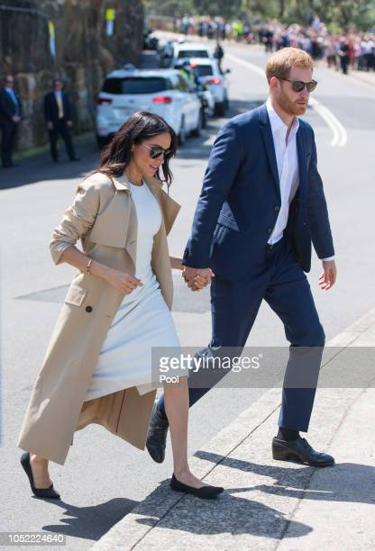 Prince Harry Duke of Sussex and Meghan Duchess of Sussex depart after visiting Taronga Zoo on October 16 2018 in Sydney Australia The Duke and...