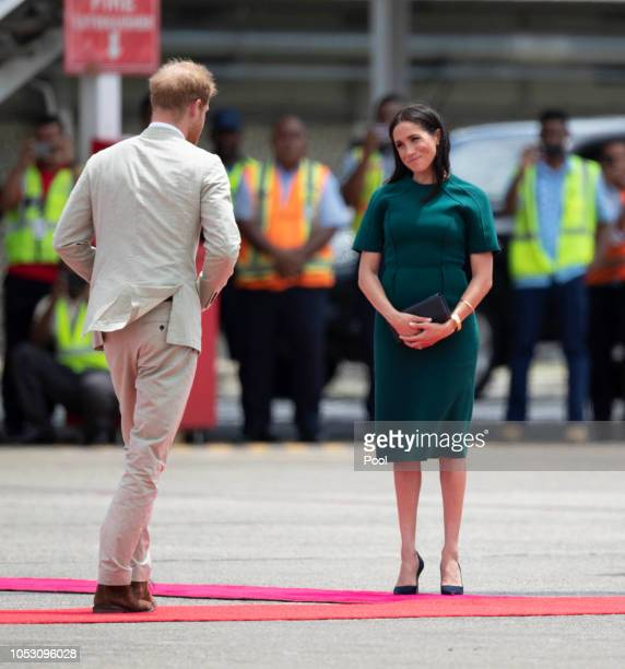 Prince Harry Duke of Sussex and Meghan Duchess of Sussex depart Fiji on their way to Tonga on October 25 2018 in Suva Fiji The Duke and Duchess of...