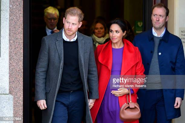 Prince Harry Duke of Sussex and Meghan Duchess of Sussex depart from Birkenhead Town Hall on January 14 2019 in Birkenhead England