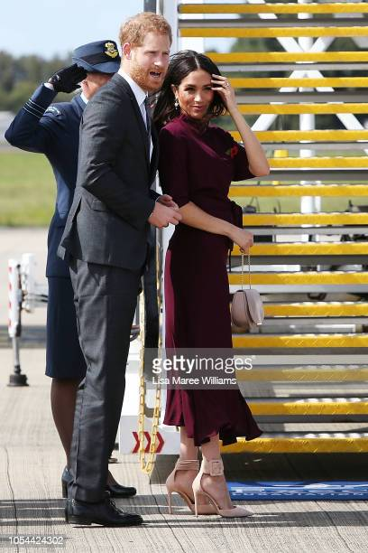 Prince Harry Duke of Sussex and Meghan Duchess of Sussex depart Sydney Airport on October 28 2018 in Sydney Australia The Duke and Duchess of Sussex...