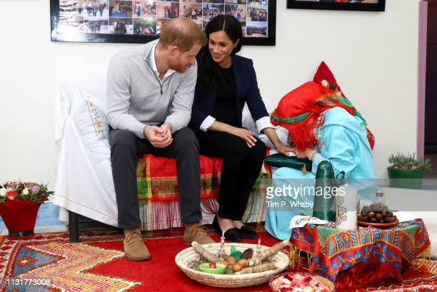 Prince Harry Duke of Sussex and Meghan Duchess of Sussex during a Henna ceremony as they visit the Education For All boarding house for girls aged 12...
