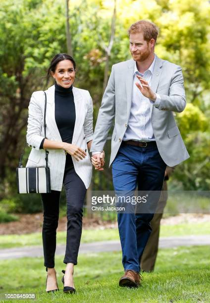 Prince Harry, Duke of Sussex and Meghan, Duchess of Sussex during day two of the Invictus Games Sydney 2018 at Sydney Olympic Park on October 21,...