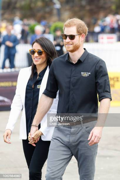 Prince Harry, Duke of Sussex and Meghan, Duchess of Sussex during the JLR Drive Day at Cockatoo Island on October 20, 2018 in Sydney, Australia.