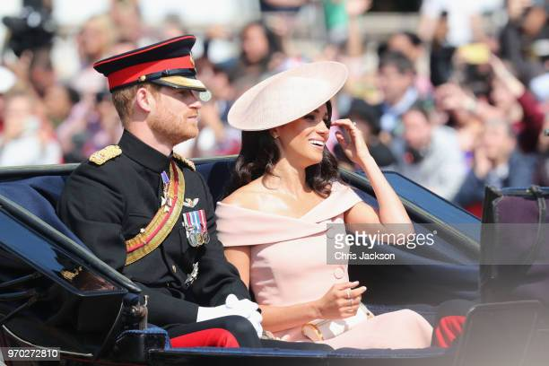 Prince Harry Duke of Sussex and Meghan Duchess of Sussex during Trooping The Colour on the Mall on June 9 2018 in London England The annual ceremony...