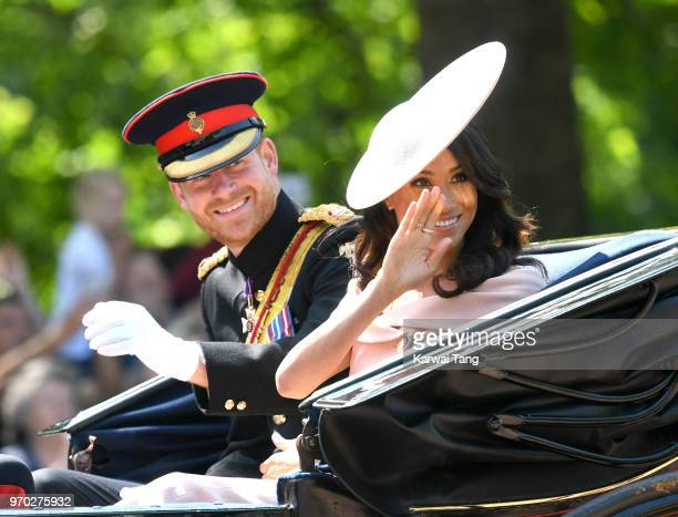 Prince Harry Duke of Sussex and Meghan Duchess of Sussex during Trooping The Colour 2018 at The Mall on June 9 2018 in London England The annual...