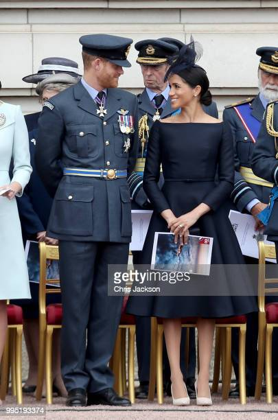 Prince Harry Duke of Sussex and Meghan Duchess of Sussex during the RAF 100 ceremony at Buckingham Palace as members of the Royal Family attend...