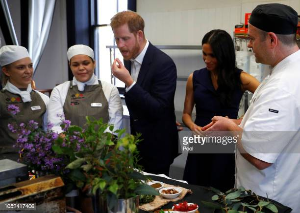 Prince Harry Duke of Sussex and Meghan Duchess of Sussex eat traditional native Australian ingredients during a visit to Mission Australia social...
