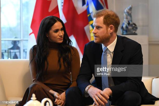 Prince Harry Duke of Sussex and Meghan Duchess of Sussex gesture during their visit to Canada House in thanks for the warm Canadian hospitality and...