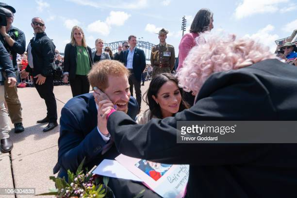 Prince Harry Duke of Sussex and Meghan Duchess of Sussex greet Daphne Dunne at Sydney Opera House on October 16 2018 in Sydney Australia The Duke and...