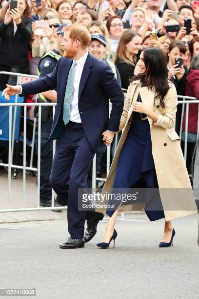 Prince Harry Duke of Sussex and Meghan Duchess of Sussex greet fans outside Government House on October 18 2018 in Melbourne Australia The Duke and...