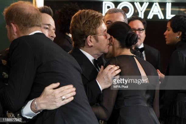 Prince Harry, Duke of Sussex and Meghan, Duchess of Sussex greet British singer-songwriter Elton John and David Furnish at the European Premiere of...