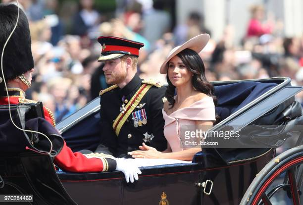 Prince Harry Duke of Sussex and Meghan Duchess of Sussex head back down the Mall to Buckingham Palace during Trooping The Colour on June 9 2018 in...
