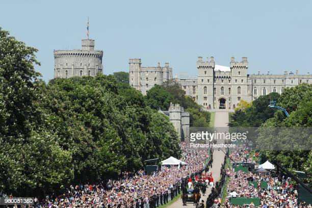 Prince Harry Duke of Sussex and Meghan Duchess of Sussex head up The Long Walk back into Windsor Castle in the Ascot Landau carriage during the...