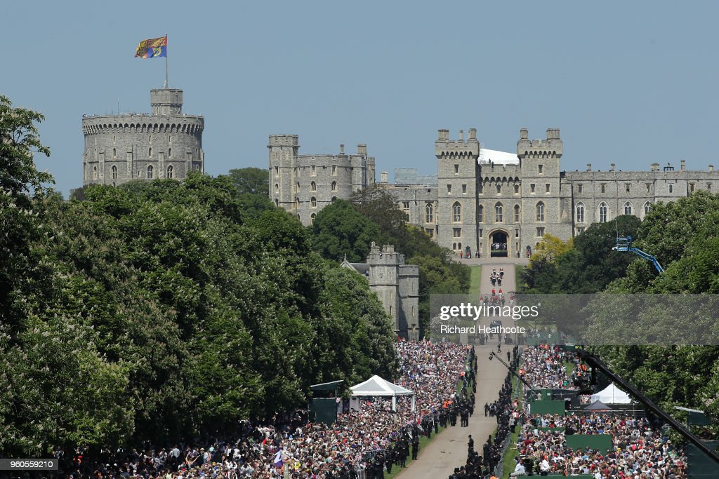 Prince Harry, Duke of Sussex and Meghan, Duchess of Sussex head up The Long Walk back into Windsor Castle in the Ascot Landau carriage during the procession after getting married St George's Chapel, Windsor Castle on May 19, 2018 in Windsor, England. Prince Henry Charles Albert David of Wales marries Ms. Meghan Markle in a service at St George's Chapel inside the grounds of Windsor Castle. Among the guests were 2200 members of the public, the royal family and Ms. Markle's Mother Doria Ragland.