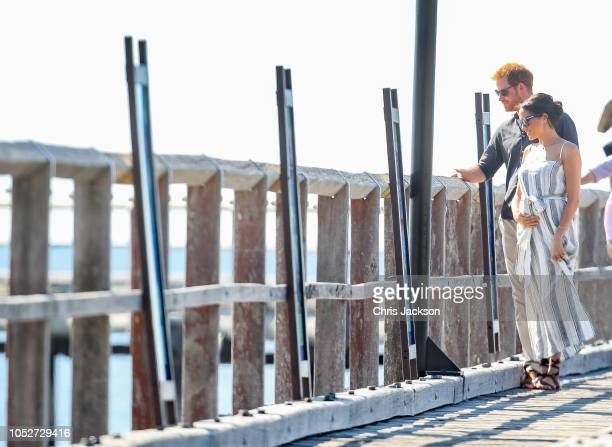 Prince Harry Duke of Sussex and Meghan Duchess of Sussex holding baby bump walking along Kingfisher bay walk about on October 22 2018 in Fraser...