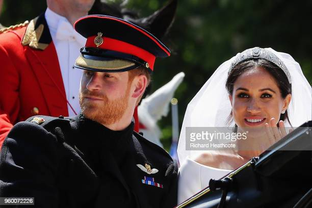 Prince Harry Duke of Sussex and Meghan Duchess of Sussex in the Ascot Landau carriage during the procession on The Long Walk after getting married St...