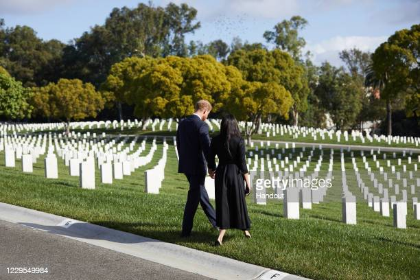 Prince Harry Duke of Sussex and Meghan Duchess Of Sussex lay a wreath at Los Angeles National Cemetery on Remembrance Sunday on November 8 2020 in...