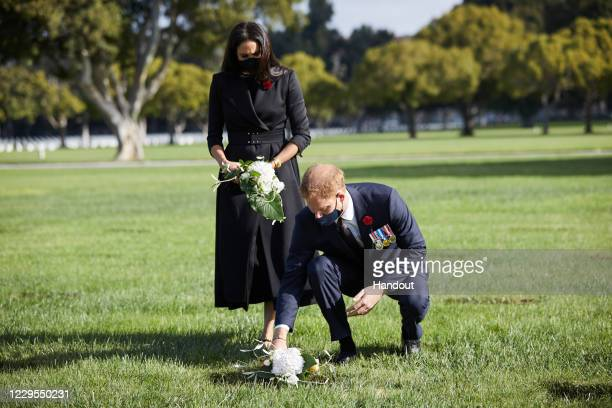 Prince Harry, Duke of Sussex and Meghan, Duchess Of Sussex lay a wreath at Los Angeles National Cemetery on Remembrance Sunday on November 8, 2020 in...