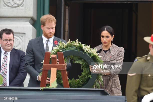 Prince Harry Duke of Sussex and Meghan Duchess of Sussex Laying Wreath at the National War Memorial on October 28 2018 in Wellington New Zealand The...