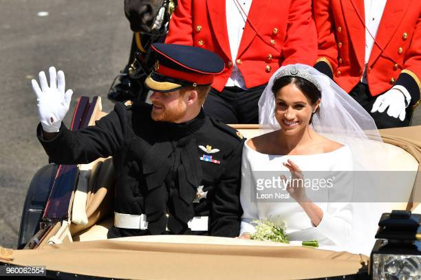 Prince Harry, Duke of Sussex and Meghan, Duchess of Sussex leave Windsor Castle in the Ascot Landau carriage during a procession after getting...