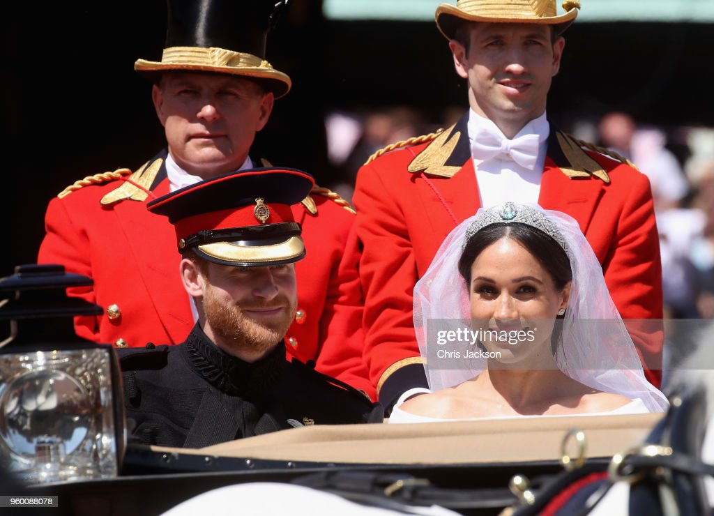 Prince Harry, Duke of Sussex and Meghan, Duchess of Sussex leave Windsor Castle in the Ascot Landau carriage during a procession after getting married at St Georges Chapel on May 19, 2018 in Windsor, England. Prince Henry Charles Albert David of Wales marries Ms. Meghan Markle in a service at St George's Chapel inside the grounds of Windsor Castle. Among the guests were 2200 members of the public, the royal family and Ms. Markle's Mother Doria Ragland.