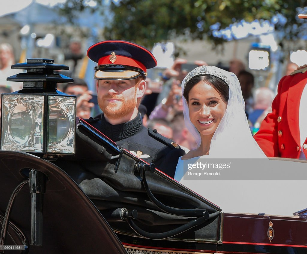 Prince Harry, Duke of Sussex and Meghan, Duchess of Sussex leave Windsor Castle in the Ascot Landau carriage during a procession after getting married at St Georges Chapel on May 19, 2018 in Windsor, England. Prince Henry Charles Albert David of Wales marries Ms. Meghan Markle in a service at St George's Chapel inside the grounds of Windsor Castle. Among the guests were 2200 members of the public, the royal family and Ms. Markle's mother, Doria Ragland.