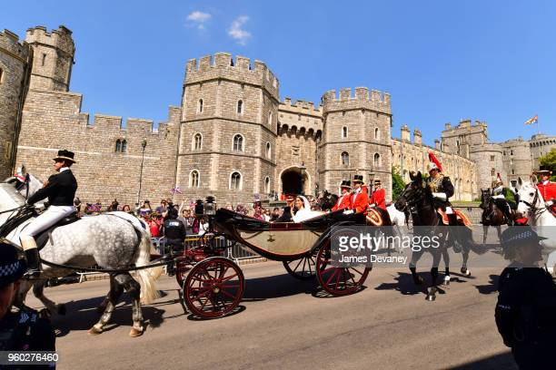 Prince Harry Duke of Sussex and Meghan Duchess of Sussex leave Windsor Castle in the Ascot Landau carriage during the procession after getting...