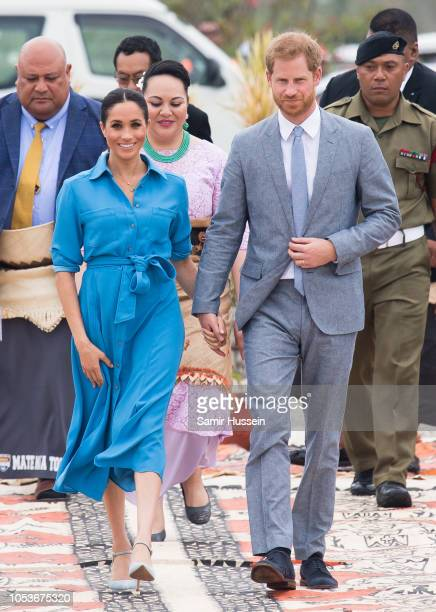 Prince Harry, Duke of Sussex and Meghan, Duchess of Sussex leave Nuku'alofa airport on October 26, 2018 in Nuku'alofa, Tonga. The Duke and Duchess of...