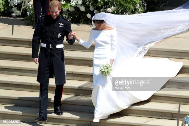 Prince Harry Duke of Sussex and Meghan Duchess of Sussex leave St George's Chapel Windsor Castle after their wedding ceremony on May 19 2018 in...