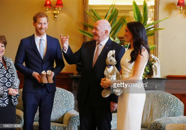 Prince Harry, Duke of Sussex and Meghan, Duchess of Sussex look at a plush kangaroo with Australia's Governor General Peter Cosgrove and wife Lynne...
