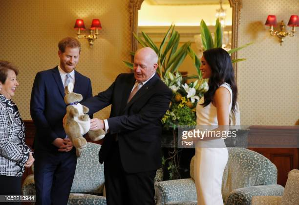Prince Harry Duke of Sussex and Meghan Duchess of Sussex look at a plush kangaroo with Australia's Governor General Peter Cosgrove and wife Lynne...