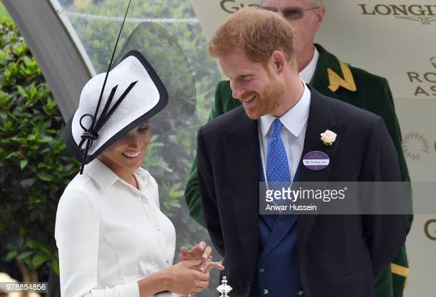 Prince Harry Duke of Sussex and Meghan Duchess of Sussex making her Royal Ascot debut attend the first day of Royal Ascot on June 19 2018 in Ascot...