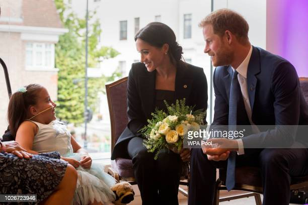 Prince Harry Duke of Sussex and Meghan Duchess of Sussex meet 7 year old Matilda Booth during the annual WellChild awards at Royal Lancaster Hotel on...